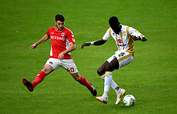 Charlton Athletic's Ben Dempsey (left) and Milton Keynes  Dons' Ousseynou Cisse (right) battle for the ball