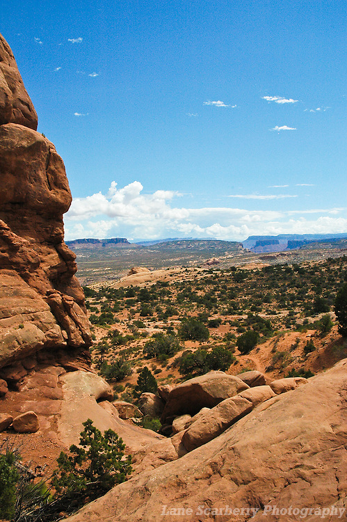 """Arches National Park contains the world's largest concentration of natural stone arches. This National Park is a red, arid desert, punctuated with oddly eroded sandstone forms such as fins, pinnacles, spires, balanced rocks, and arches. The 73,000-acre region has over 2,000 of these """"miracles of nature."""""""