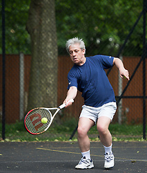 © London News Pictures. 20/05/2014. John Bercow MP,  Speaker of the House of Commons, playing tennis in Westminster, London. Photo credit: Ben Cawthra/LNP