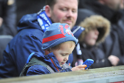 YOUNG CHELSEA FAN ON HIS MOBILE, MK Dons v Chelsea,  FA Cup 4th Round Stadium MK Sunday 31st January 2016