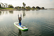Haley Austurias paddling and performing SUP yoga on Mission Bay, San Diego CA.