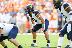 Sep 1, 2018; Charlotte, NC, USA; West Virginia Mountaineers linebacker Dylan Tonkery (10) waits for a snap during the first quarter against the Tennessee Volunteers at Bank of America Stadium. Mandatory Credit: Ben Queen-USA TODAY Sports