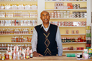KELAAT M'GOUNA, MOROCCO - 14TH MAY 2016 - Portrait of a local shop owner selling rose water and oils and other rose based cosmetic and culinary products, Dades Valley Southern Morocco.