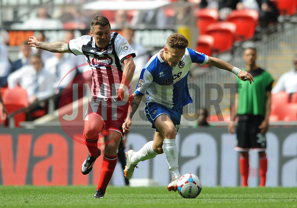 Bristol Rovers' Matt Taylor is challenged by Grimsby's Scott Brown - Photo mandatory by-line: Dougie Allward/JMP - Mobile: 07966 386802 - 17/05/2015 - SPORT - football - London - Wembley Stadium - Bristol Rovers v Grimsby Town - Vanarama Conference Football