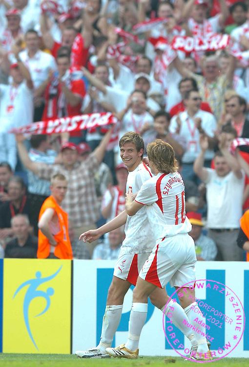n/z.: Bartosz Bosacki (nr19-Polska) cieszy sie po zdobyciu gola dla Polski podczas meczu grupy A Polska (bialo-czerwone) - Kostaryka (czerwone) podczas turnieju finalowego Mistrzostw Swiata Niemcy 2006 , pilka nozna , Niemcy , Hanower , 20-06-2006 , fot.: Adam Nurkiewicz / mediasport..Bartosz Bosacki (nr19-Poland) celebrates his goal for Poland during soccer match group A in Hannover during World Cup 2006. June 20, 2006 ; Poland (white-red) - Costa Rica (red) ; football , Germany , Hannover ( Photo by Adam Nurkiewicz / mediasport )