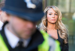 © London News Pictures. 19/12/2013 . TULISA CONTOSTAVLOS  standing while a statement is read on her behalf after  leaving Westminster Magistrates court on London where she faced charges of supplying a class A drug. Former X-Factor judge Tulisa and Mike GLC (real name Michael Coombs)  are accused of supplying a class A drug to an investigative journalist. Photo credit : Ben Cawthra/LNP