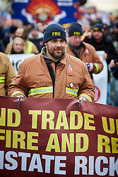 © Licensed to London News Pictures.  09/12/2014. AYLESBURY, UK. Thousands of fire fighters march through Aylesbury during the latest  nationwide strike of Fire Brigade Union members over pension rights. the union is also intending to take legal action over the dismissal of Ricky Matthews by the Buckinghamshire and Milton Keynes Fire Authority for taking part in pervious industry action. <br /> <br /> In this picture: Sacked firefighter Ricky Matthews<br /> <br /> Photo credit: Cliff Hide/LNP