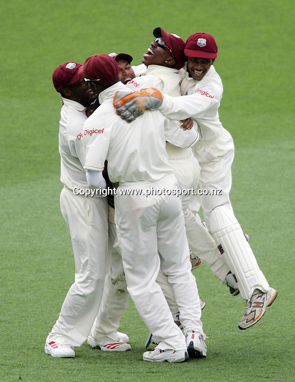 The West Indies celebrate with Daren Ganga after running out Nathan Astle for 13 runs during day 3 of the 1st cricket test match between the West Indies and the New Zealand Black Caps at Eden Park, Auckland, New Zealand on Saturday 11 March, 2006. Photo: Hannah Johnston/PHOTOSPORT<br />