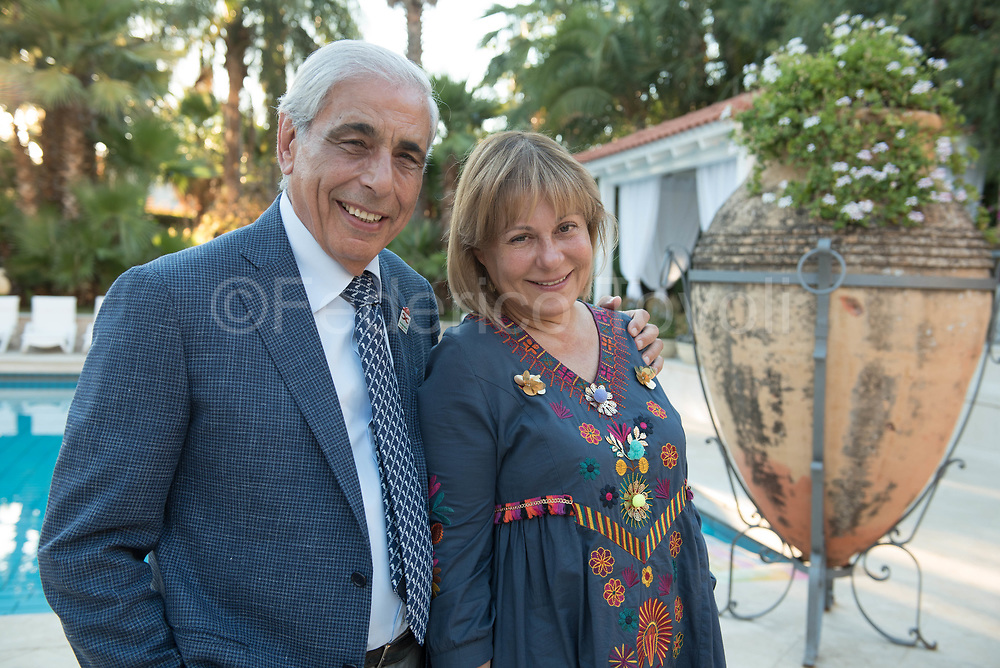 Tommaso Dragotto founder and manager of Sicilybycar, in his home, with his wife