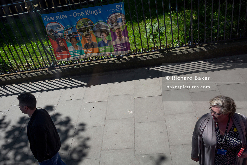South Londoners and an NHS banner outside King's College Hospital in Camberwell, on 14th May, in London, England.