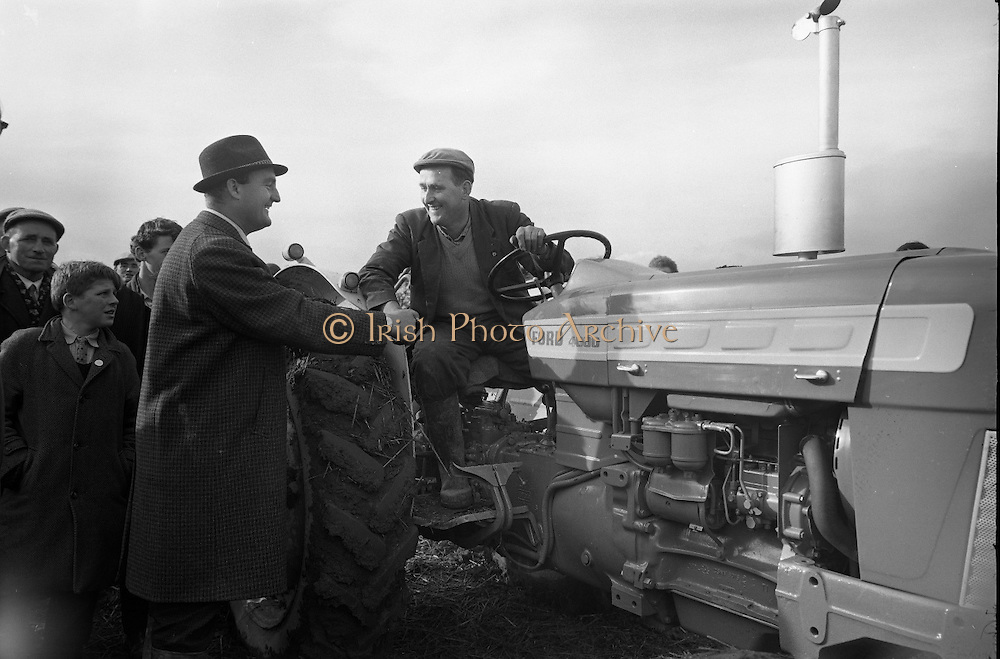 National Ploughing Championships at Tullow, Co. Carlow.  James Murphy, Carlow, winner of the Supreme Award, is congratulated..26.10.1967<br />