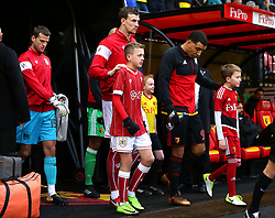 Aden Flint of Bristol City leads his side out with mascot - Mandatory by-line: Robbie Stephenson/JMP - 06/01/2018 - FOOTBALL - Vicarage Road - Watford, England - Watford v Bristol City - Emirates FA Cup third round proper