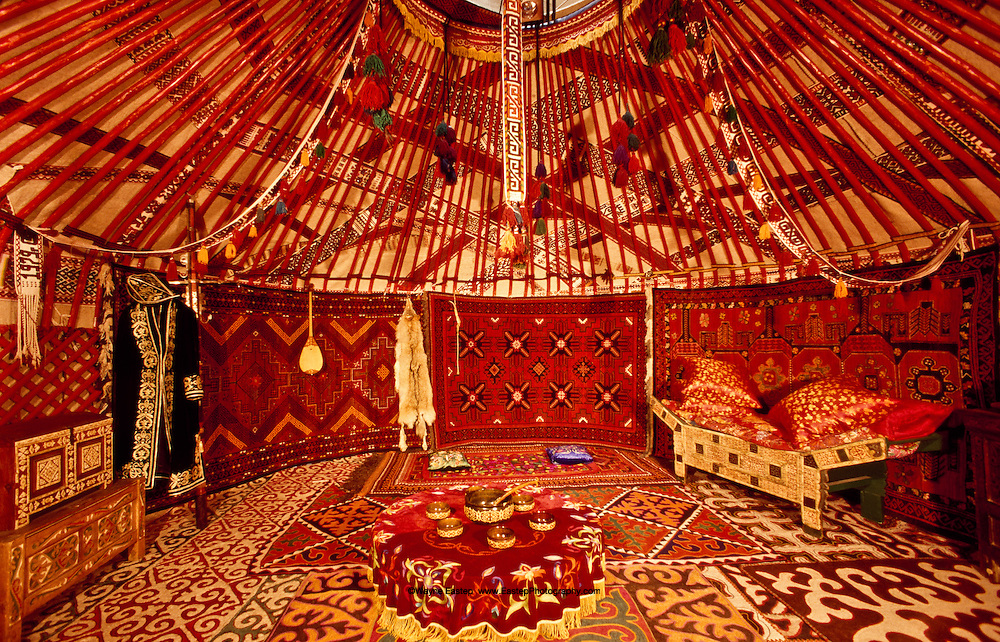 The Yurt is a unique structure, a physical and metaphorical expression of Kazakh nomadic life.  It is an oasis of life and color, a nuturing place of safety where family and friends come together.  It is ironic that the Yurt - a small, self-contained structure in the vastness of the steppes - has within it a generous spaciousness.  The Yurt is where art, life and nature merge.  The art style is marked by ornamental improvisation and reflects the passionate, open and joyful Kazakh personality.  The use of natural materials ordered by the human hand creates a harmony of colors and shapes much like a flower arrangement.  To live inside a Yurt is to live inside art.  Central State Museum, Almaty, Kazakhstan