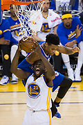 Golden State Warriors forward Draymond Green (23) is fouled by Philadelphia 76ers forward Robert Covington (33) during a lay up attempt at Oracle Arena in Oakland, Calif., on March 14, 2017. (Stan Olszewski/Special to S.F. Examiner)