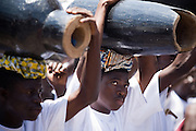 Young men carry drums on top of their heads during the parade held on the occasion of the annual Oguaa Fetu Afahye Festival in Cape Coast, Ghana on Saturday September 6, 2008.