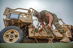 U.S. Marine Pfc. Jeremiah Hargraves, a motor transport operator with Combat Logistics Battalion 15, takes chains off a Utility Task Vehicle in preparation for San Francisco Fleet Week 2018 on Marine Corps Base Camp Pendleton, California, Sept. 27, 2018. San Francisco Fleet Week features a unique training and education program that brings together civilian and military forces. The cooperation and coordination of relationships established during the week-long occasion fosters the development and sharing of best practices in humanitarian assistance recognized by the United States Department of Defense as the model for fleet weeks across the country. (U.S. Marine Corps photo by Cpl. Jacob Farbo)