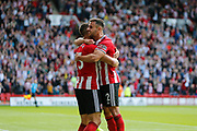 George Baldock of Sheffield United and Phil Jagielka of Sheffield United celebrates winning after the Premier League match between Sheffield United and Crystal Palace at Bramall Lane, Sheffield, England on 18 August 2019.