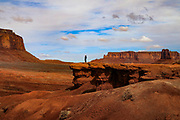 A visitor stands on John Ford Point in Monument Valley on the Utah-Arizona Border
