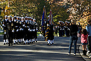 ARLINGTON, VA - NOVEMBER 11: Brooke Abbott, 7, of Virginia (R), watches as honor guards from each military branch make their way through Arlington National Cemetery on Veteran's Day November 11, 2012 in Arlington, Virginia.