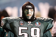 A Philadelphia Eagles fan wearing a painted face, jersey, and shoulder pads looks on during the NFL NFC Wild Card football game against the New Orleans Saints on Saturday, Jan. 4, 2014 in Philadelphia. The Saints won the game 26-24. ©Paul Anthony Spinelli
