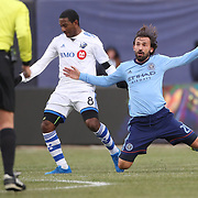 NEW YORK, NEW YORK - March 18:  Andrea Pirlo #21 of New York City FC is pushed off the ball by Patrice Bernier #8 of Montreal Impact during the New York City FC Vs Montreal Impact regular season MLS game at Yankee Stadium on March 18, 2017 in New York City. (Photo by Tim Clayton/Corbis via Getty Images)
