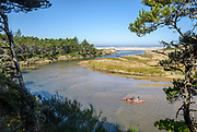 Couple paddling kayak on the Siltcoos River, Oregon Dunes National Recreation Area, Oregon Coast.