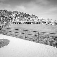 Catalina Island tiki umbrella black and white photo with the Catalina Casino, Avalon Pier, and Avalon Harbor. Beautiful Santa Catalina Island is a popular travel destination off the Southern California coast. Photo is high resolution. Copyright ⓒ 2017 Paul Velgos with All Rights Reserved.