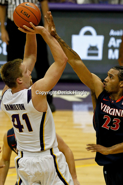 January 2, 2012; Baton Rouge, LA; LSU Tigers center Justin Hamilton (41) shoots over Virginia Cavaliers forward Mike Scott (23) during the second half of a game at the Pete Maravich Assembly Center. Virginia defeated LSU 57-52.  Mandatory Credit: Derick E. Hingle-US PRESSWIRE