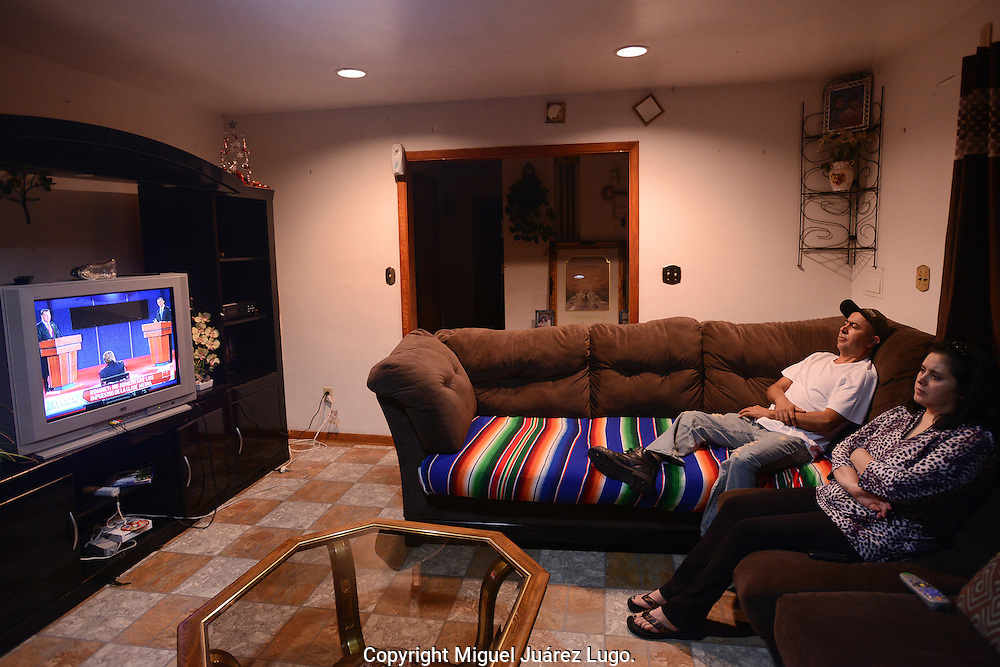 PAINESVILLE, OH - OCT 15, 2012.- Mexican American couple, Pacual Rodriguez and his wife Teresa, watched  with concern the first presidential debate between Barack Obama and Mitt Romney in the living room of his house in this village in Northern Ohio.  This County is considered to be the most divided in the swing state of Ohio that Obama won by just a few hundred votes in 2008.  They plan to vote on Obama and hope that the participation of the Latino community became a factor in the results of the presidential elections. (Photo by Miguel Juárez Lugo).