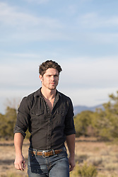 handsome man walking outdoors