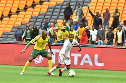 South Africa: Johannesburg: Bafana Bafana player Sandile Hlanti battle for the ball with Seychelles player Jude Nancy during the Africa Cup Of Nations qualifiers at FNB stadium, Gauteng.<br />