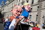 On the day that Members of Parliament sat on a Saturday (the first time in 37 years and dubbed 'Super Saturday') in order to vote for Prime Minister Boris Johnson's Brexit deal with the EU in Brussels, a Johnson and Dominic Cummings parody were wheeled through streets alongside a million Remainers (according to organisers) marched through the capital to voice their opposition to a Brexit and calling for a peoples' Vote, on 19th October 2019, in London, England.