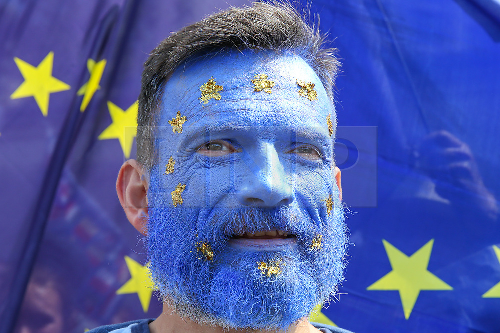 """© Licensed to London News Pictures. 20/07/2019. London, UK. A protester is seen with his face painted in the colours of the EU flag as Pro EU demonstrators take part in the """"No to Boris. Yes to Europe"""" march in central London. Photo credit: Dinendra Haria/LNP"""