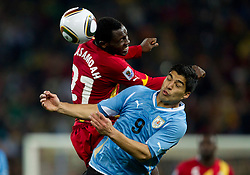 Kwadwo Asamoah of Ghana vs Luis Suarez of Uruguay during the overtime at  2010 FIFA World Cup South Africa Quarter Finals football match between Uruguay and Ghana on July 02, 2010 at Soccer City Stadium in Sowetto, suburb of Johannesburg. Uruguay defeated Ghana after penalty shots. (Photo by Vid Ponikvar / Sportida)