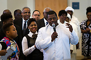 Reverend Marcus Allen introduces new members during service at Zion Baptist Church in Madison, Wisconsin, Sunday, Feb. 4, 2018.