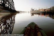 Panama, Panama 061706   A kayaker crosses path with a container ship crossign the Panama Canal near the Miraflores Locks in the Gamboa area.  (Photo by Essdras M Suarez/EMS Photography