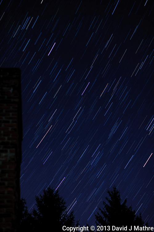 Star trails looking east from my backyard. Autumn night sky in New Jersey. Composite of 18 images taken with a Nikon D3x camera and 58 mm f/1.4 lens (ISO 100, 58 mm, f/2, 30 sec).