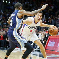12 April 2016: Los Angeles Clippers guard Pablo Prigioni (9) drives past Memphis Grizzlies guard Xavier Munford (14) during the Los Angeles Clippers 110-84 victory over the Memphis Grizzlies, at the Staples Center, Los Angeles, California, USA.