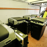Lee Kimble, an employee with Lee County, loads up voting machines for District 5 on Monday morning at the Lee County Justice Center in Tupelo.