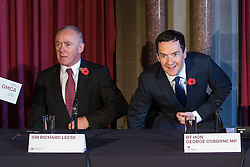 © Licensed to London News Pictures . 03/11/2014 . Manchester , UK . Sir Richard Leese and the Chancellor of the Exchequer , George Osborne MP , at Manchester Town Hall signing a deal to devolve power to Greater Manchester , including giving the city a Mayor and greater control over its finances . Photo credit : Joel Goodman/LNP