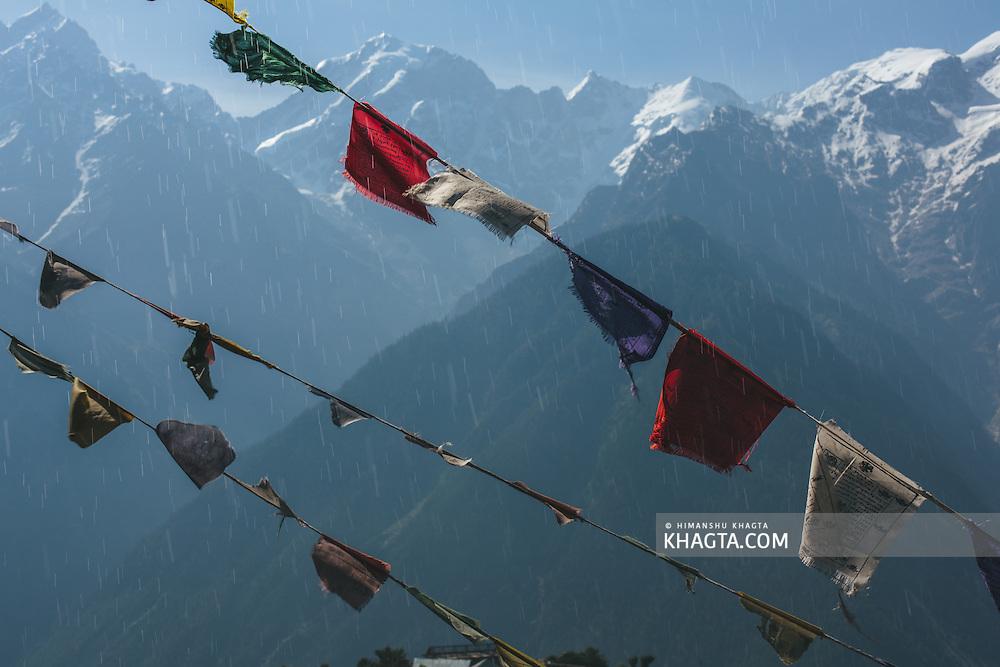 Prayer flags in front o f a beautiful Landscape of Kinnaur Kailash mountains from Kalpa, Kinnaur