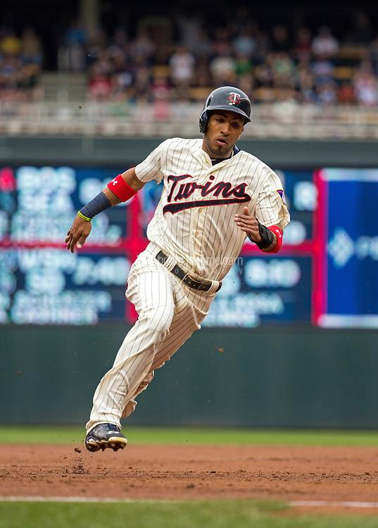 MINNEAPOLIS, MN- MAY 16: Eddie Rosario #20 of the Minnesota Twins runs against the Tampa Bay Rays on May 16, 2015 at Target Field in Minneapolis, Minnesota. The Twins defeated the Rays 6-4. (Photo by Brace Hemmelgarn) *** Local Caption *** Eddie Rosario