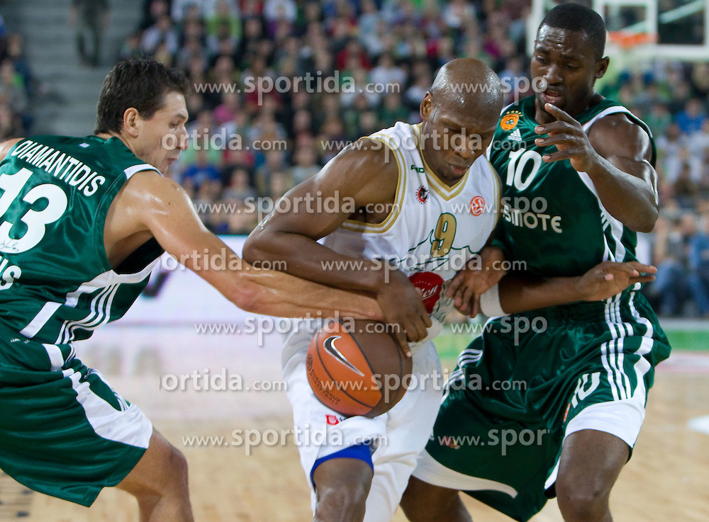 Kenny Gregory (9) of Olimpija  between Dimitris Diamantidis of Panathinaikos and Romain Sato of Panathinaikos during basketball match between KK Union Olimpija (SLO) and Panathinaikos (GRE) in Group D of Turkish Airlines Euroleague, on November 4, 2010 in Arena Stozice, Ljubljana, Slovenia. Union Olimpija defeated Panathinaikos 85-84. (Photo By Vid Ponikvar / Sportida.com)