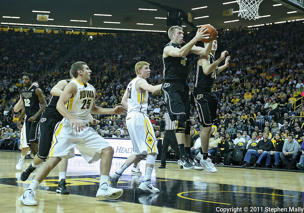 December 28, 2011: Purdue Boilermakers forward Robbie Hummel (4) pulls in a rebound during the NCAA basketball game between the Purdue Boilermakers and the Iowa Hawkeyes at Carver-Hawkeye Arena in Iowa City, Iowa on Wednesday, December 28, 2011. Purdue defeated Iowa 79-76.