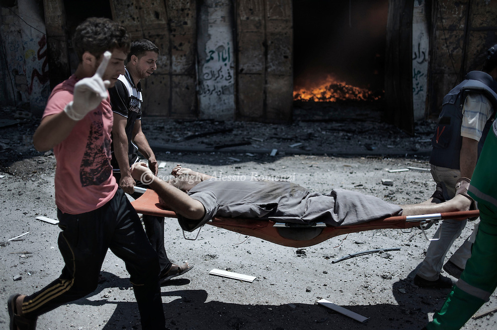 Gaza Strip, Gaza City: Medics evacuate an injured man from Gaza's eastern Shejaiya district. ALESSIO ROMENZI