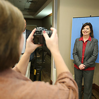 Cathy Mitchell has her photo make by Lorie Bryant for her new North Mississippi Medical Center ID badge as employees and the hospital begin the transition to NMMC Gilmore-Amory.