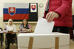 A voter casts her ballot at a polling station in Bratislava, Slovakia, March 5, 2016. The ninth general election in Slovakia's history kicked off at 7 a.m. local time (0600 GMT) Saturday, with some 4.4 million eligible voters expected to cast their vote in 5,992 polling stations nationwide for the 150-member parliament. EXPA Pictures © 2016, PhotoCredit: EXPA/ Photoshot/ Andrej Klizan<br />