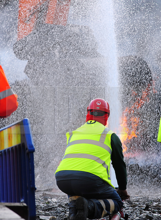 © Licensed to London News Pictures. 02/11/2016<br /> A workman spraying was onto a fire as work continues.<br /> The BIG WASTE4FUEL clean up has started at the ex-recycling site in Cornwall Drive,St Pauls Cray,Orpington,Kent.<br /> Over the next 20 weeks more than 18.000 tonnes of waste will be removed from the site by the councils recycling partner Veolia with the work overseen by the environment agency.  The first of the lorries arrived yesterday. . Photo credit: Grant Falvey/LNP