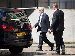 © Licensed to London News Pictures. 26/05/2017. London, UK. Labour party leader Jeremy Corbyn leaves via a back door after making an election speech in Westminster. All election campaigning was stopped as a mark of respect for the victims of Monday's terror attack in Manchester in which 22 people died. Photo credit: Peter Macdiarmid/LNP