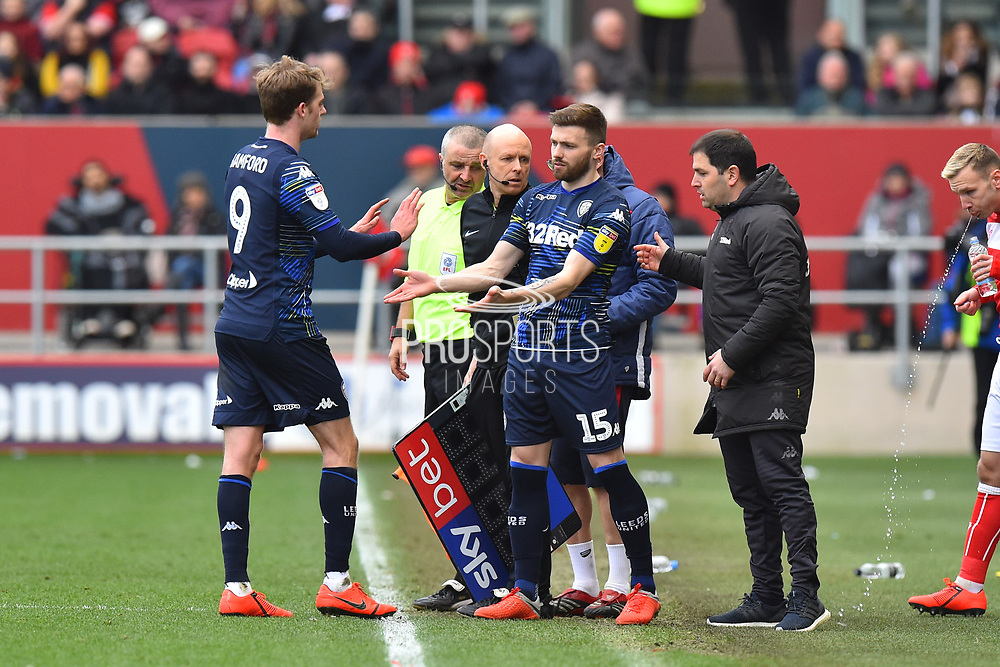 Substitution - Stuart Dallas (15) of Leeds United replaces Patrick Bamford (9) of Leeds United during the EFL Sky Bet Championship match between Bristol City and Leeds United at Ashton Gate, Bristol, England on 9 March 2019.